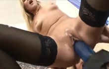 Blonde hoe in stockings squirts on that huge strapon